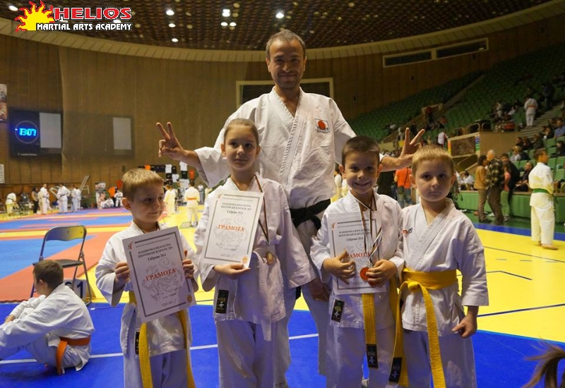 Small samurai with awards from the National Shotokan Karate Cup